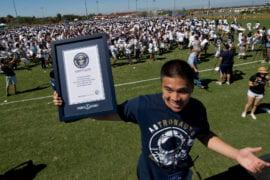 Student holding world record display