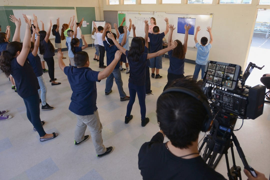 Fourth grade students at West Orange Elementary warm up with ESCAPE teaching artist Dawn Dyson-Platero before an arts and sciences integrated dance lesson on weathering and erosion.   Alex Ray / ESCAPE