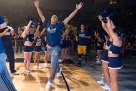 Men's basketball team taking the floor