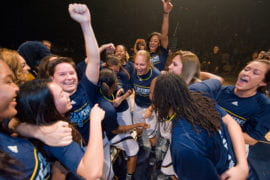 Women's Basketball team celebrating