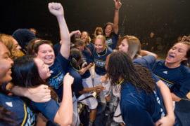 Women's Basketball team celebrating