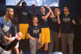 Men's Basketball team cheering during 3 point contest