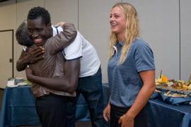 Manadou Ndiaye hugging UC President Janet Napolitano
