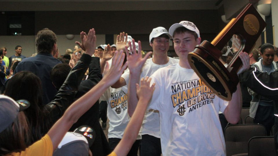 Collin Mehring with the NCAA trophy