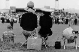 Two women watching the UCI site dedication