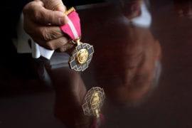 Satya Atluri holding his award