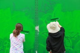 Students painting over Graffiti