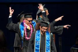 Graduates celebrating onstage
