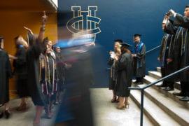 Graduate entering commencement