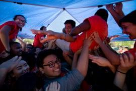 Student pile under tarp