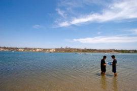 Thomas Cho and Sang Ban collect water and sediment samples