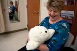 "Kirsten Osgood accompanied by robotic baby seal ""Paro"""