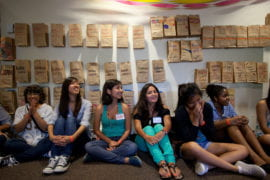 "Wall of paper-bag ""mailboxes"" for SPOP participants"