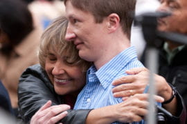 Carol Zapata-Whelan hugs her son Vincent Whelan