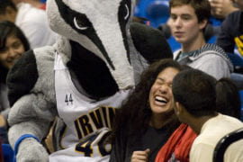 Students hugging Peter The Anteater