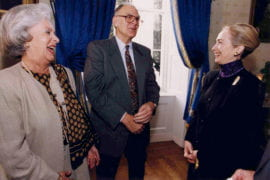 Rowland with wife Joan laughing with Hillary Clinton