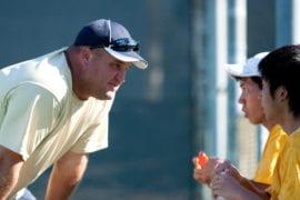 Trevor Kornenmann talks to his players