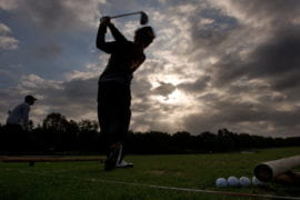 Lalita Patipaksiri practicing golf