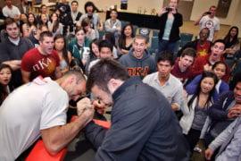 Jeremy Sharib and Dominic Tardivel arm wrestle for fundraiser