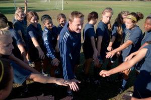Scott Juniper with the women's soccer team