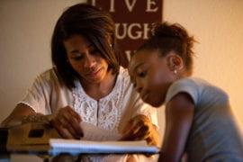 Santana reviews her daughter's homework