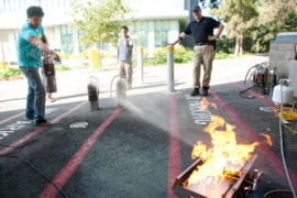 Matt Cody practices extinguishing propane flames.