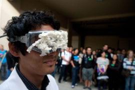 Volunteer Stephen Sasaki demonstrates eye contamination
