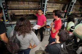 Alvin Samala shows students how to operate a fume hood