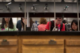 Students peruse lab safety handouts