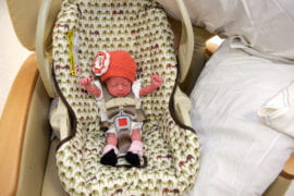Elise in her much larger car seat.