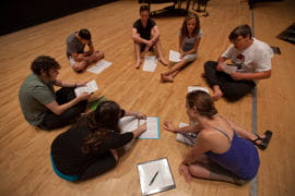 Drama students review their sheet music