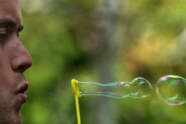 Senior Robert Jones blows bubbles
