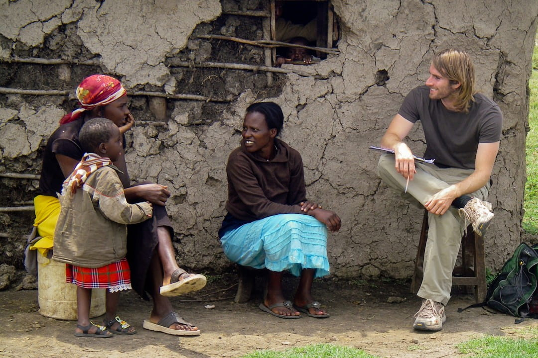 Morgan Bailey talks with local residents of a Kenyan community