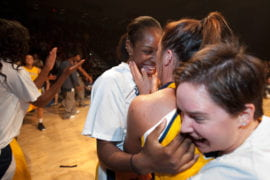 Women's basketball team members celebrating