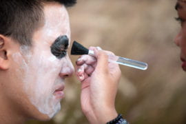 Chris Vo getting costume makeup applied