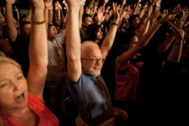 Crowd with their hands in the air