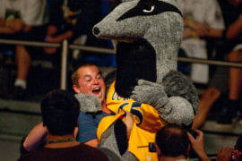 Student excitedly carrying Peter the Anteater