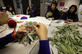 UCI students bundle sage for the tribe's April 30 Earth Day celebration