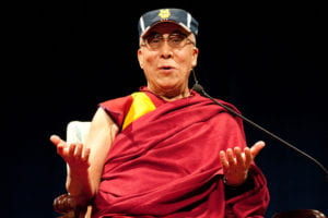 the Dalai Lama sporting an Anteaters visor