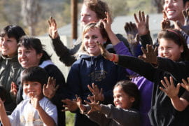 UCI students and children from the tribe's after-school program show their dirty hands and big smiles