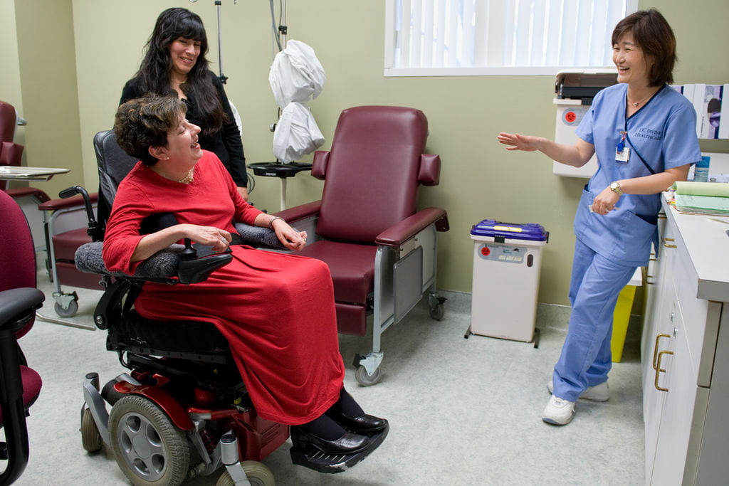 MS patient Shirley Cero jokes with nurse Monica Shim and her caregiver Elsa Palomino