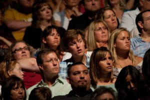 Audience members listen intently to the Dalai Lama's address.