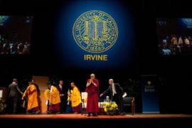 The Dalai Lama greets audience members