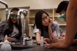 Khanh Tran helps chemistry lab students