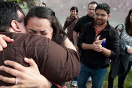 Marco Angulo gives his fiancee, Anabell, a hug