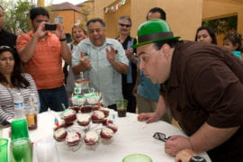 Marco Angulo blows out candles