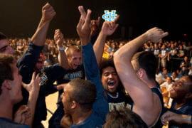Men's basketball team celebrating