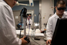 The surgical team readies the laser imaging equipment