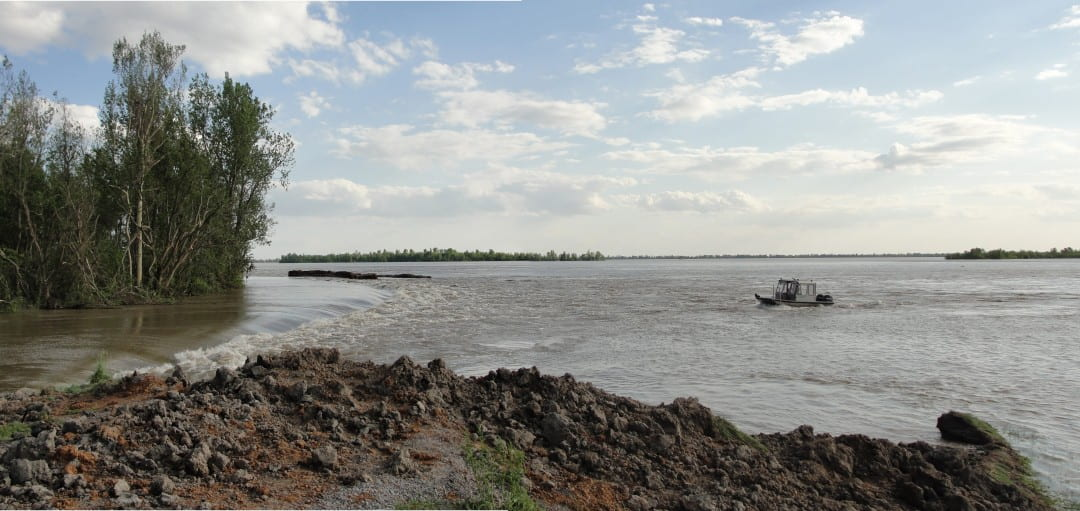 A boat crew from the U.S. Geological Survey measures the effects of levee detonations, meant to ease flood risk along the Mississippi River in 2011. Courtesy of USGS