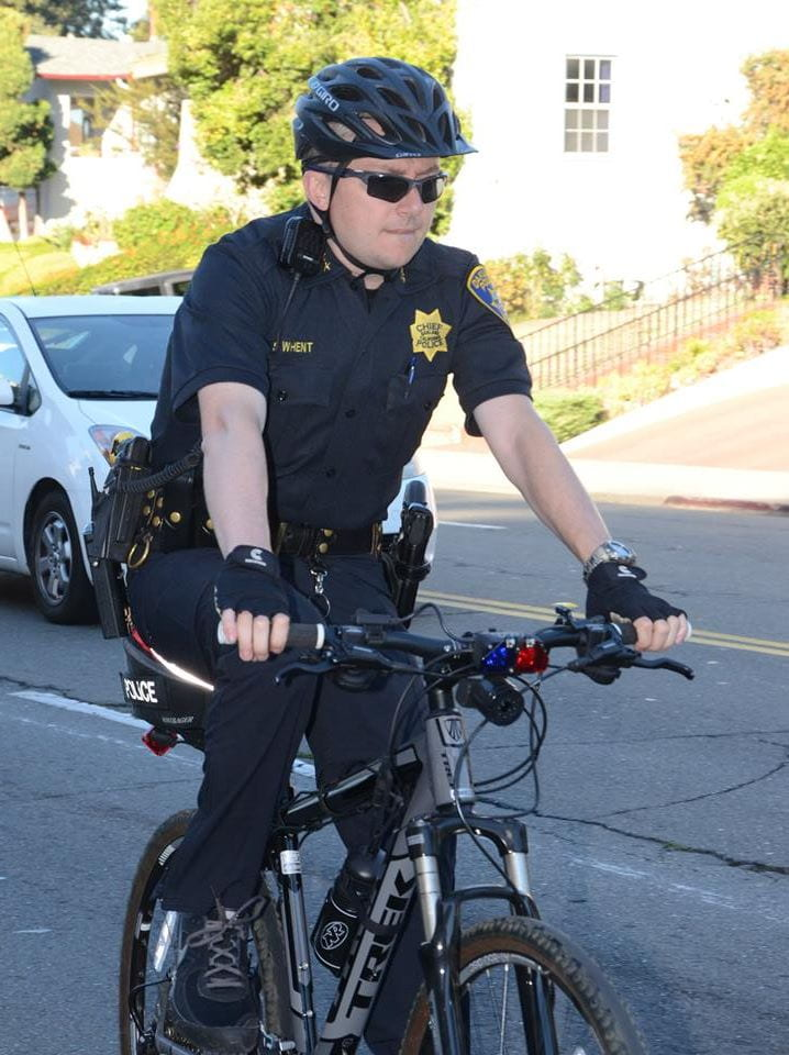 Chief Whent riding his bike through the hills of Oakland